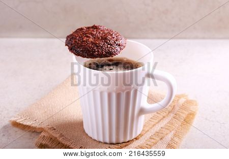 Rye chocolate cookies and cup of coffee