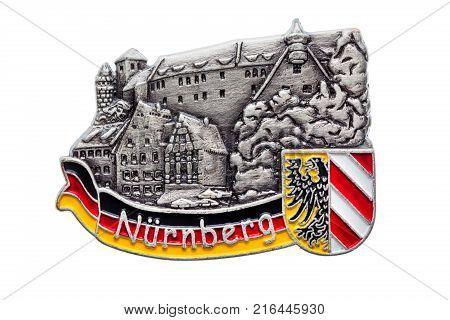Germany souvenir refrigerator magnet Nuremberg Nurnberg Emblem isolated on white. Refrigerator magnets are popular souvenirs.