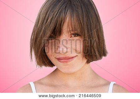 Close Up Portrait Of Freckled Stylish Small Kid Looks With Narrow Dark Eyes Directly Into Camera, Ha