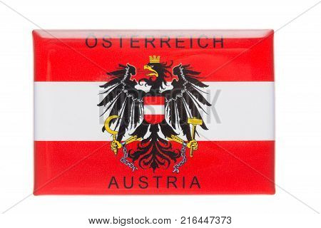 Austria souvenir refrigerator magnet Austria Emblem isolated on white. Refrigerator magnets are popular souvenirs.