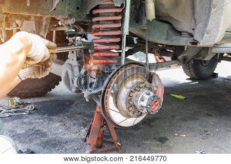 Car repair workers use hot gas to repair the car undercarriage Automotive industry and garage concepts.