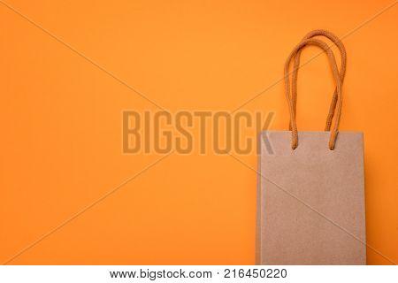 Craft Cardboard Gift Bag On Orange Background
