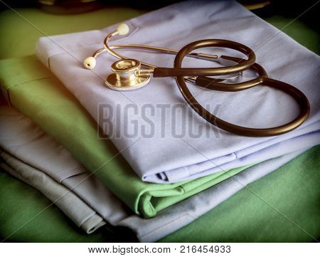 Stethoscope about blue and green nurse uniform in a hospital, conceptual image