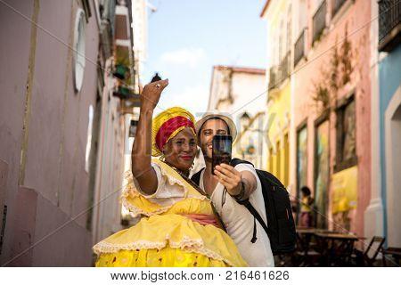 Tourist taking selfie photos with Brazilian women