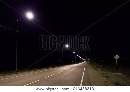 Lonesome asphalt road at night in summer