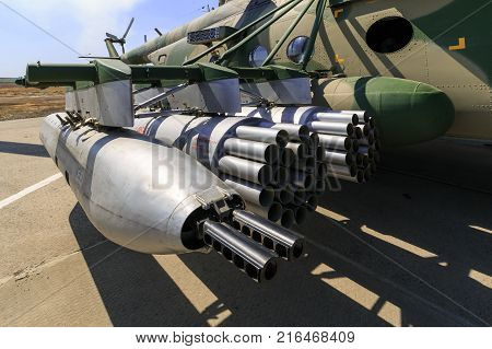 KADAMOVSKIY TRAINING GROUND ROSTOV REGION RUSSIA 26 AUGUST 2017: International military technical forum «ARMY-2017». Hanging gun and launch devices for uncontrolled missiles mounted on military helicopter MI-8AMTSH