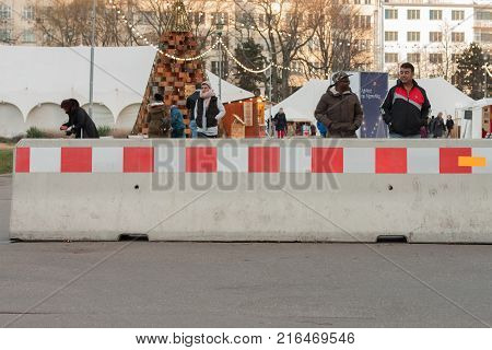 Brno,Czech Republic-November 27,2017: Iron concrete barriers protection against terrorism at Christmas market at Moravian Square and walking people on November 27, 2017 Brno, Czech Republic
