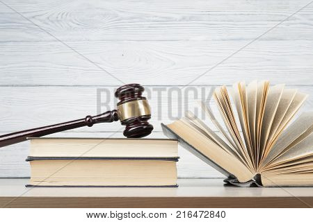 Law concept. Books with wooden judge gavel on table in a courtroom or enforcement office