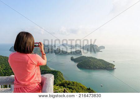 Woman Tourist On Peak Viewpoint Of Island
