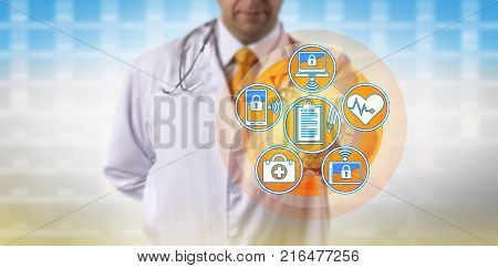 Unrecognizable doctor synchronizing patient medical records across portable devices. Healthcare concept for health information technology electronic medical records practice management system.