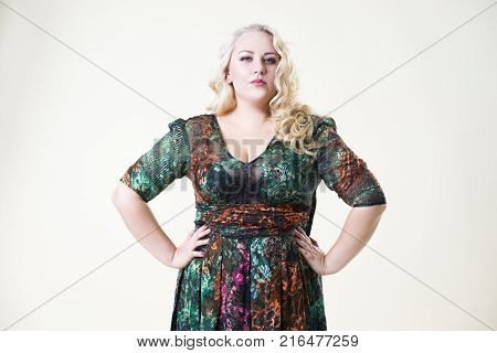 Plus size fashion model fat woman on beige studio background overweight female body