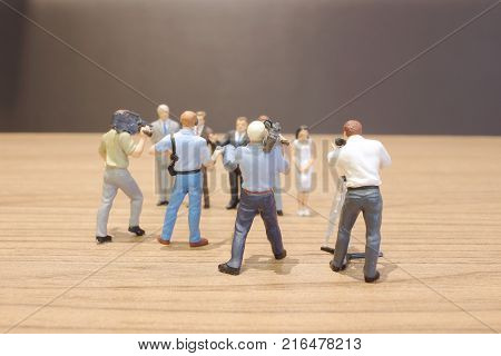 The Figure Of  Busines People On Stage