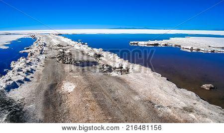 Remote empty road through the Salar de Uyuni in Bolivia