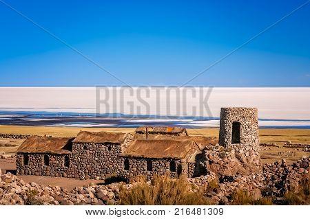 Old primitive abandoned building in a tiny village on the shore of Salar de Uyuni in Bolivia