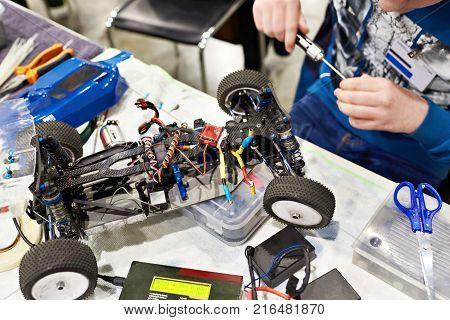 Radio Control Panels And Man Repairs Radiocontrolled Car For Racing