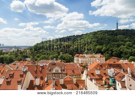 View of old buildings at the Mala Strana District (Lesser Town) and Petrin Lookout Tower at the Petrin Hill in Prague, Czech Republic, in the daytime.