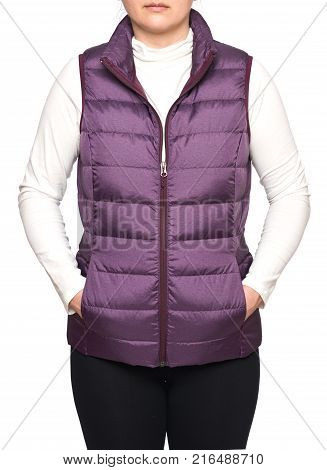Young woman wearing dark plum down vest isolated on white background