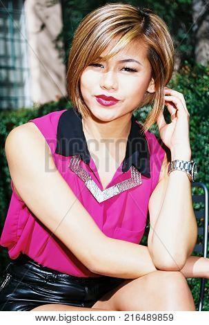 A lovely model female model posing outdoors