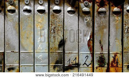 Close up old rusty metallic mail boxes