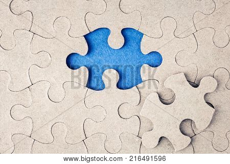 The missing piece of the puzzle. A piece of the puzzle is not inserted into its place. Completion of the absence of the concept of a puzzle for business