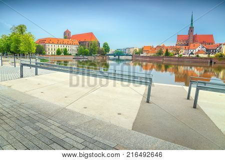 Fantastic cityscape with Odra river and St John cathedral near Ostrow Tumski island Wroclaw Poland Europe