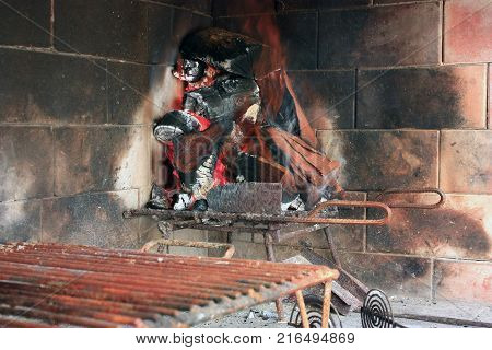 Making an Argentine barbecue. Preparing the fire and embers. The grill empty.