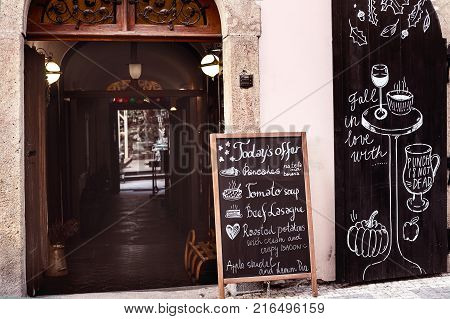 Prague Czech Republic. January 22 2017: beautiful empty narrow street in Mala Strana and cozy street caffe with wooden doors and a tiny tunnel