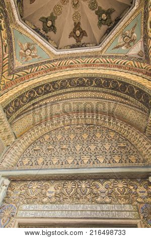VAGHARSHAPAT ARMENIA - SEPTEMBER 17 2017: The decor of the main entrance to Etchmiadzin Mother Cathedral includes gilt relief Byzantine patterns