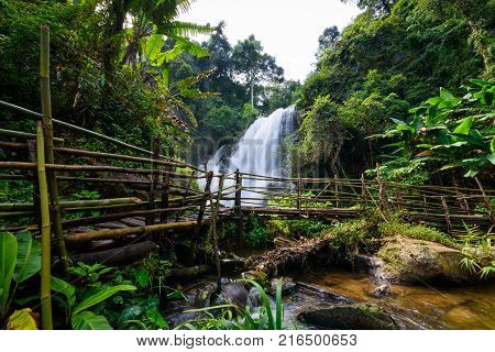 beautiful waterfall in northern Thailand name Pha dok siew waterfall in Doi intanon national park with bamboo bridge.