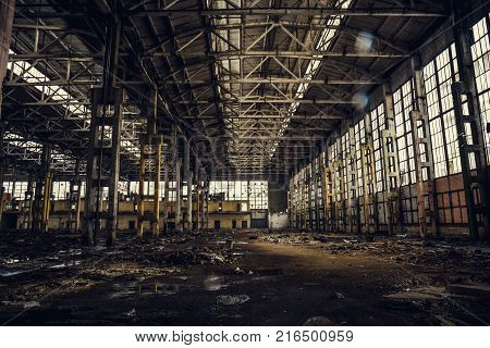 Old dirty broken ruined abandoned building or warehouse, ruins of industrial factory, toned