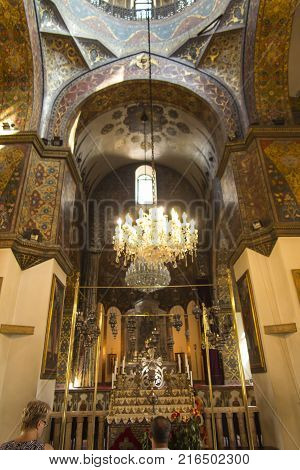 VAGHARSHAPAT ARMENIA - SEPTEMBER 17 2017: Inside one of the oldest Etchmiadzin Cathedrals in the world. It has unique architectural style and design. Altar with chandelier