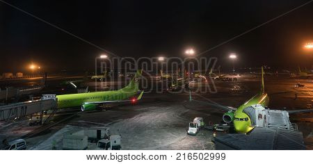 Moscow, Russia - January 29, 2017: loading and departure of airplanes at the airport Domodedovo, night view