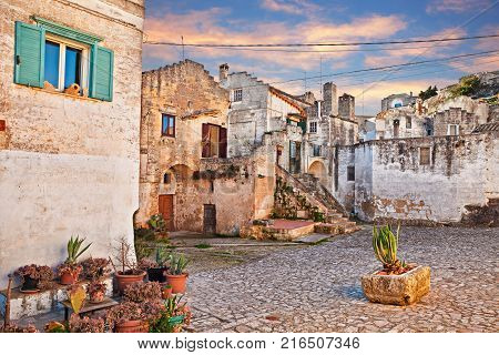 Matera, Basilicata, Italy: picturesque cityscape at sunrise of an ancient small square in the old town named Sassi di Matera - City European Capital of Culture 2019