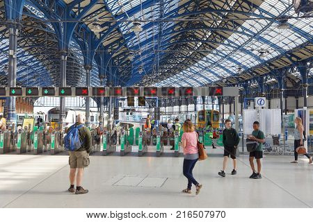 Brighton Great Britain - Jun 19 2017: People Waiting For The Train In The Train Station In Brighton