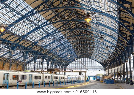 BRIGHTON GREAT BRITAIN - JUN 19 2017: The beautiful train station in Brighton UK made of steel painted in blue. June 27 2017 in Brighton Great Britain