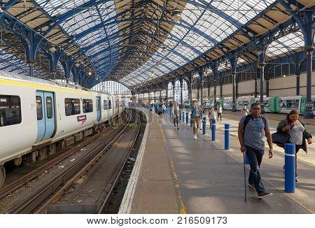 BRIGHTON GREAT BRITAIN - JUN 19 2017: People walking on the platform in the train station in Brighton UK. June 27 2017 in Brighton Great Britain