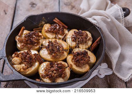 Baked apple with pecan nuts, honey and oat flakes