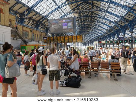BRIGHTON GREAT BRITAIN - JUN 19 2017: People waiting for the train in the train station in Brighton UK. June 19 2017 in Brighton Great Britain