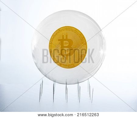 Bitcoin inside a bubble over a needles bed simulating the fragility of this speculative currency poster
