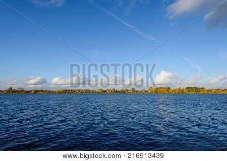 Lake With Water Reflections In Colorful Autumn Day