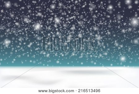 Snow on a dark background. Snow is coming, small snowflakes in the air. Snow cover