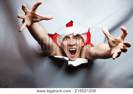 Christmas New Year Concept, Stylish Guy Santa Hat Very Surprised With White Paper Bottom And Glow Ba