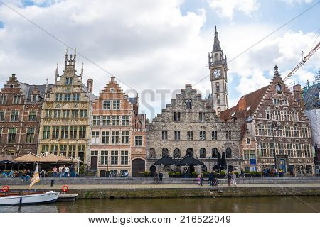 Ghent, Belgium - April 16, 2017: Graslei is a quay and one of the most picturesque places in the historic city center of Ghent, Belgium, located on the right bank of the Leie river.