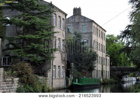 hebden bridge with the rochdale canal boats and old buildings