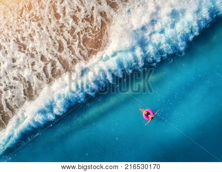 Aerial View Of Young Woman Swimming In The Sea