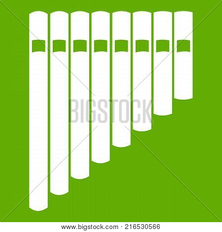 Pan flute icon white isolated on green background. Vector illustration
