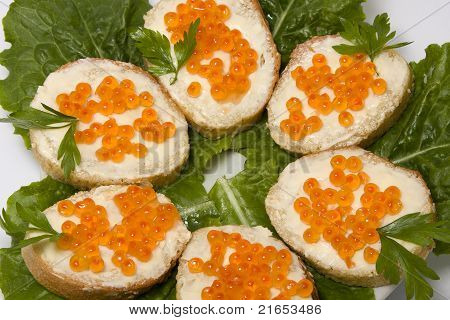 Red caviar sandwiches on white plate . poster