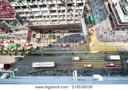 KOWLOON HONG KONG - MARCH 20 2014 - Looking down on a busy Nathan Road from Chungking Mansions Hong Kong
