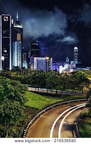 HONG KONG - OCT 25, 2009 - Night view of Hong Kong Island skyscrapers from a Causeway Bay elevated walkway