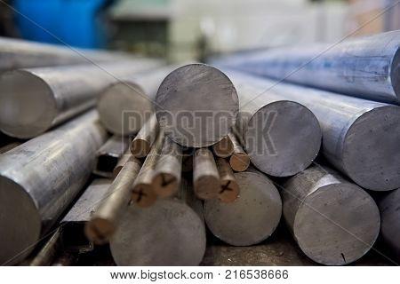 Pile of aluminium rods. Metal bars close up. Buy aluminium online.